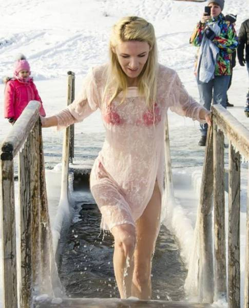 Russian Women Celebrate Orthodox Epiphany By Diving Into Icy Cold Water