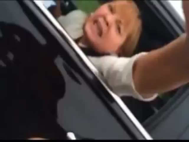 Crazy Racist Woman Freaks Out after Nearly Getting into an Accident  (VIDEO)