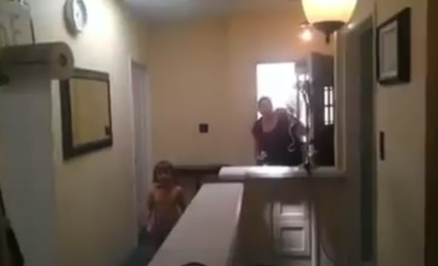 Dad and Son Fire Toilet Paper Cannon at Mom