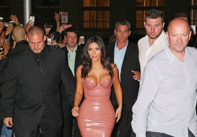 Kim Kardashian Squeezes Her Curves into Pink Latex