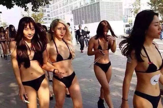 Chinese Mobile Company Uses Near Naked Models to Introduce Their New App to the World