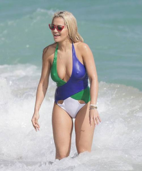 Rita Ora Shows Off Her Sexy Body In A Low Cut Swimsuit On The Miami Beach