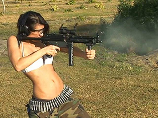 There Is Something About Hot Girls Handling Big Guns