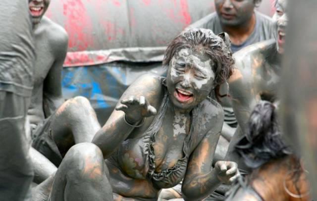 Girls Having Fun At The Korean Mud Festival